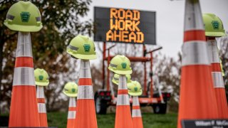 road cones with helmets on top of them