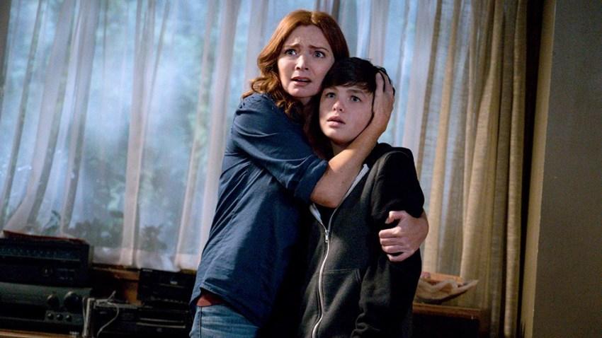"""Brigid Brannagh as Rita Johnson and Logan Williams as Max Johnson in """"Supernatural."""""""