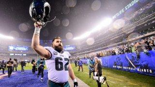 Jason Kelce raises his helmet