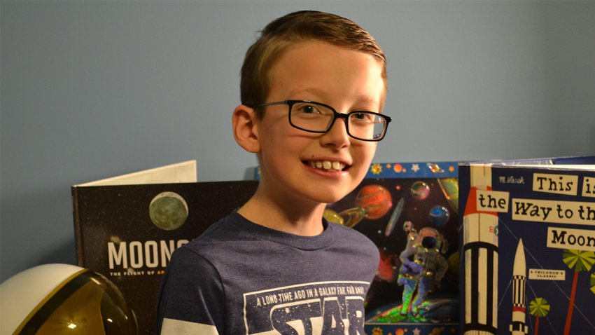 Young boy with space books