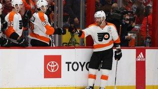 Hockey player fist-bumps teammates