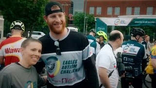 Carson Wentz wearing an Eagles Autism Challenge shirt
