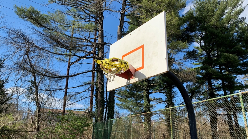 Caution tape on a basketball hoop