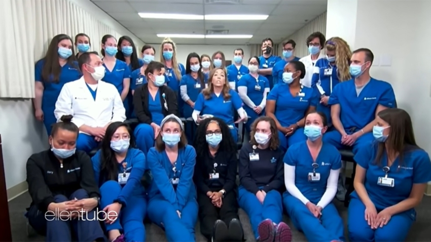 A group of nurses in scrubs and masks