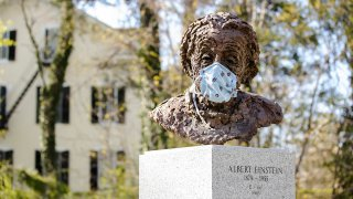 Statue of Albert Einstein in a mask