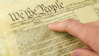 """The Bill of Rights and a finger pointing to """"We The People"""""""