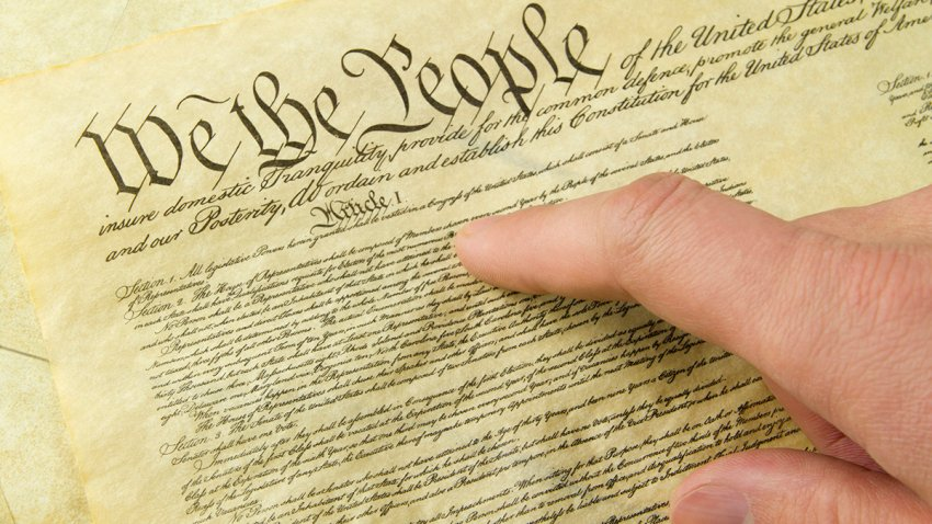 "The Bill of Rights and a finger pointing to ""We The People"""