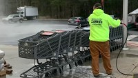 Painters Using Spray Tools to Sanitize South Jersey Shopping Carts