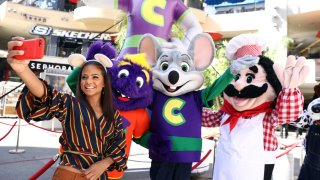 """Chuck E. Cheese mascots celebrate """"National Pizza Month"""" with Christina Milian, left, onWed., Oct. 4, 2017in Los Angeles."""