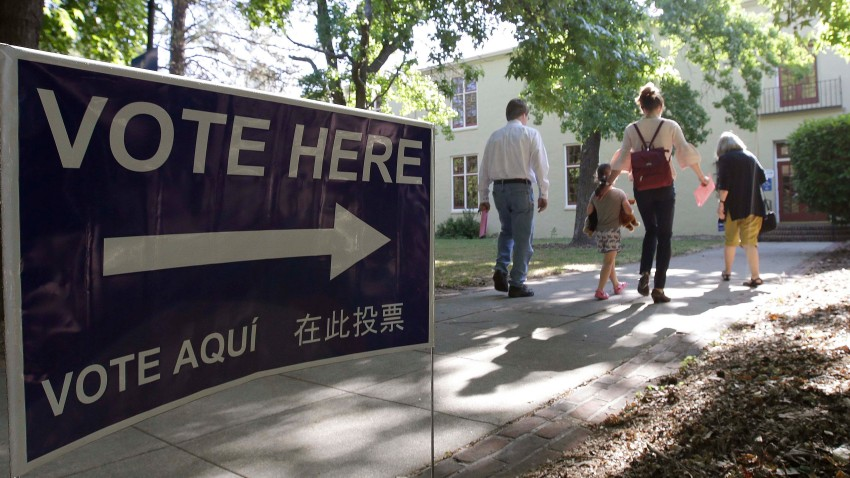In this file photo, voters walk to a precinct place at the Sierra 2 Center for the Arts and Community to cast their ballots Tuesday, June 5, 2018, in Sacramento, Calif.