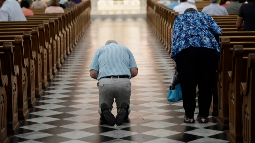 Parishioner attend mass celebrated by Bishop Ronald Gainer, of the Harrisburg Diocese, at the Cathedral Church of Saint Patrick in Harrisburg, Pennsylvania, Friday, Aug. 17, 2018.