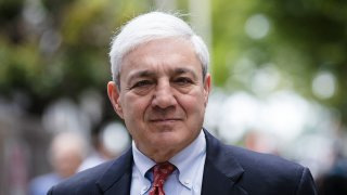 In this June 2, 2017 file photo, former Penn State President Graham Spanier departs after his sentencing hearing at the Dauphin County Courthouse in Harrisburg, Pa