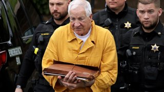 Former Penn State University assistant football coach Jerry Sandusky, center, arrives at the Centre County Courthouse to be resentenced in Bellefonte, Pennsylvania, on Nov. 22, 2019.