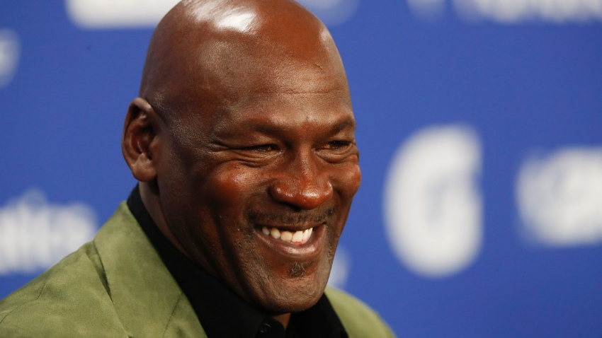 Former basketball superstar Michael Jordan speaks during a press conference ahead of NBA basketball game between Charlotte Hornets and Milwaukee Bucks in Paris, Friday, Jan. 24, 2020.
