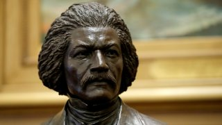 A bronze statue of abolitionist Frederick Douglass is seen during a private viewing ahead of its unveiling at the Maryland State House, Monday, Feb. 10, 2020, in Annapolis. The statue, along with a statue of Harriet Tubman, will be unveiled Monday night in the Old House Chamber, the room where slavery was abolished in Maryland in 1864.