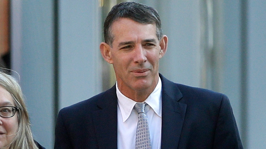 Michael Center, former men's tennis coach at the University of Texas at Austin arrives, Monday, Feb. 24, 2020, at federal court in Boston for sentencing, in a nationwide college admissions bribery scandal.