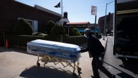 Closed Caskets, Empty Chairs at Funeral Home in Virus Center