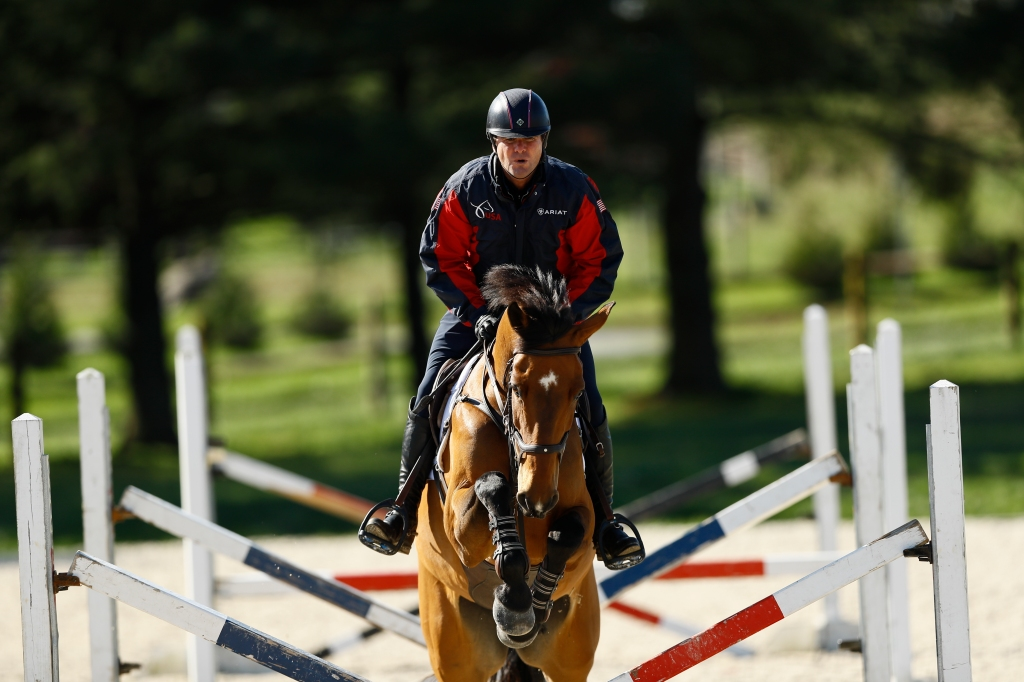 Phillip Dutton, a medal-winning equestrian on the U.S. Olympic team, rides Z, through a series of jumps while training at his farm, Thursday, April 2, 2020, in West Grove, Pa.
