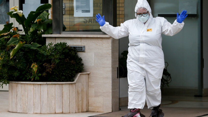 A medical staffer gestures after performing swabs for coronavirus in the Santa Cecilia nursing home in Civitavecchia, near Rome