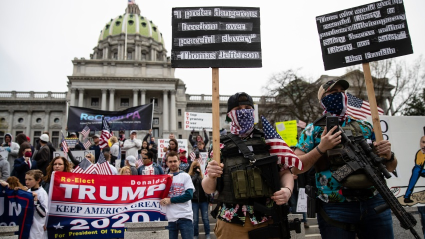 n this April 20, 2020, file photo protesters demonstrate at the state Capitol in Harrisburg, Pa., demanding that Gov. Tom Wolf reopen Pennsylvania's economy even as new social-distancing mandates took effect at stores and other commercial buildings.