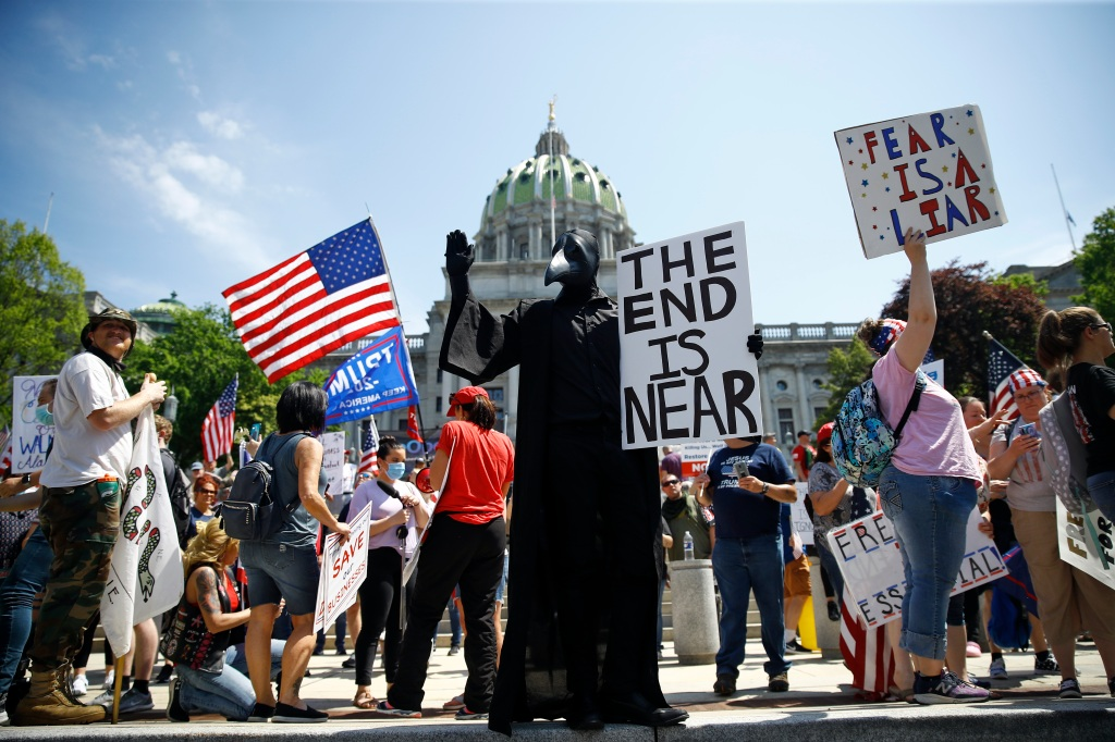 Protesters demonstrate during a rally against Pennsylvania's coronavirus stay-at-home order at the state Capitol in Harrisburg, Pa., Friday, May 15, 2020.