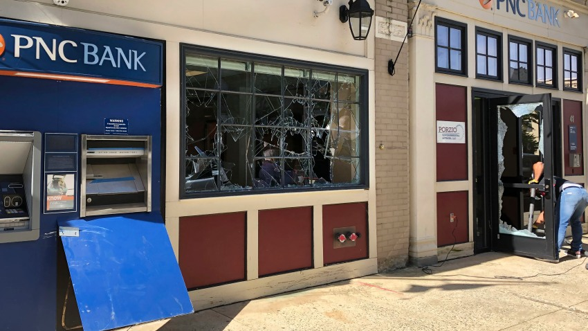 A cleanup crew began removing shards of glass and furniture at a PNC bank in Trenton, NJ, Monday, June 1, 2020.