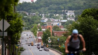 A cyclist pedals up a hill in Allentown, Pennsylvania, May 29, 2020. Allentown predicts a budget deficit of over $10 million, a number officials say could go higher if the economy doesn't rebound quickly.