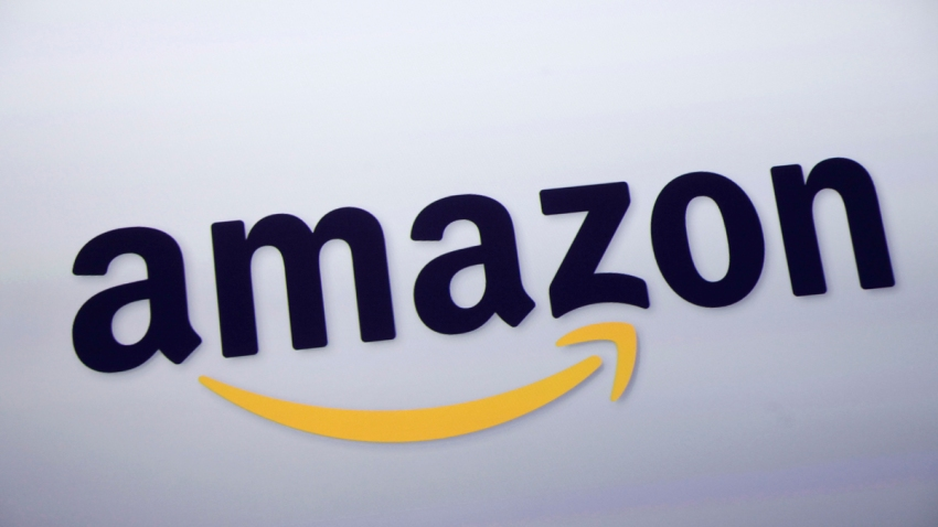 In this Sept. 28, 2011, file photo, the Amazon logo is displayed at a news conference in New York.
