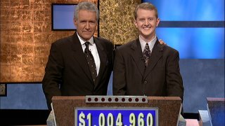 """In this July 14, 2004, file photo, """"Jeopardy!"""" host Alex Trebek poses with contestant Ken Jennings after his earnings from his record breaking streak on the gameshow surpassed $1 million in Culver City, California."""