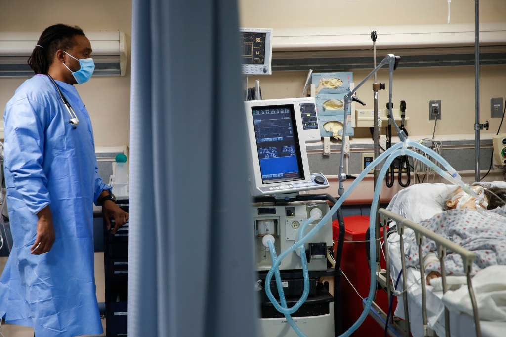 In this April 20, 2020, file photo, a nurse looks over at a COVID-19 patient who is attached to a ventilator in the emergency room at St. Joseph's Hospital in Yonkers, N.Y.