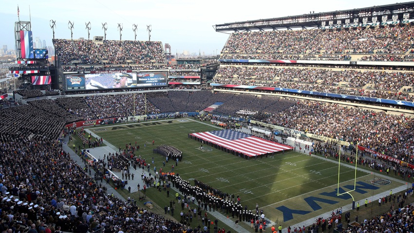 An American Flag is displayed on the field before a game between Army and Navy at Lincoln Financial Field in Philadelphia