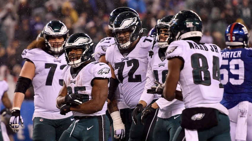 Boston Scott #35 of the Philadelphia Eagles celebrates with his teammates after scoring a touchdown against the New York Giants during the third quarter in the game at MetLife Stadium on December 29, 2019 in East Rutherford, New Jersey.