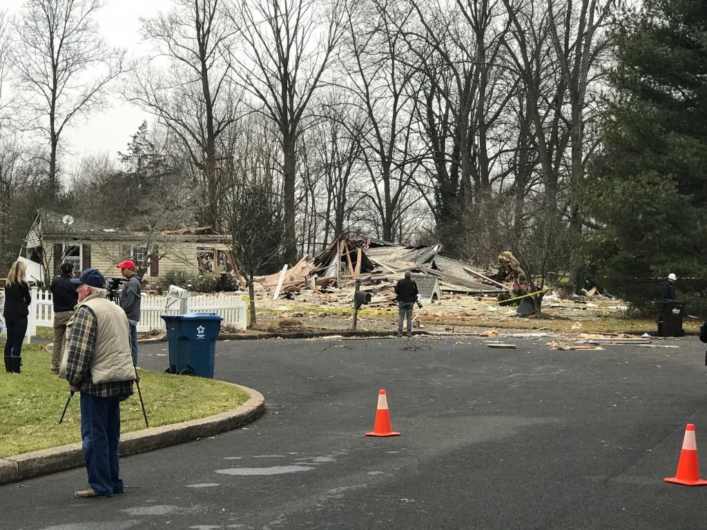 First responders outside a destoryed home