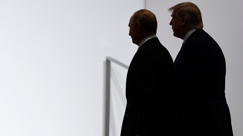 In this June 28, 2019, file photo, President Donald Trump and Russian President Vladimir Putin walk to participate in a group photo at the G20 summit in Osaka, Japan.