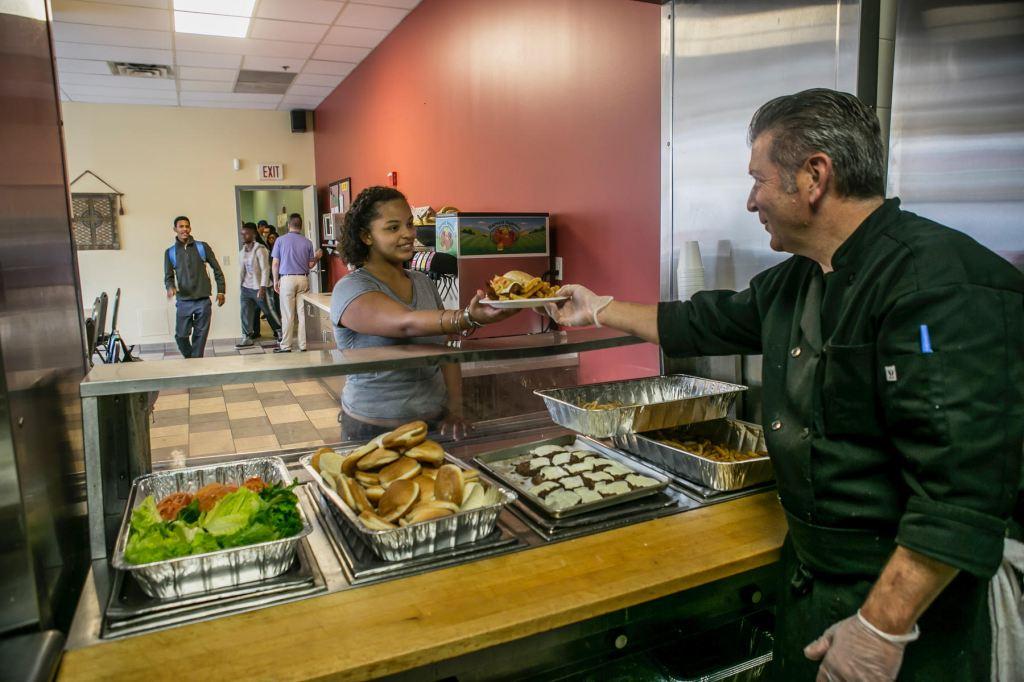 man feeding woman at food pantry