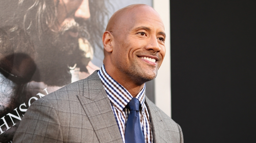 "In this July 23, 2014, file photo, actor Dwayne Johnson attends the premiere of Paramount Pictures' ""Hercules"" at TCL Chinese Theatre in Hollywood, California."