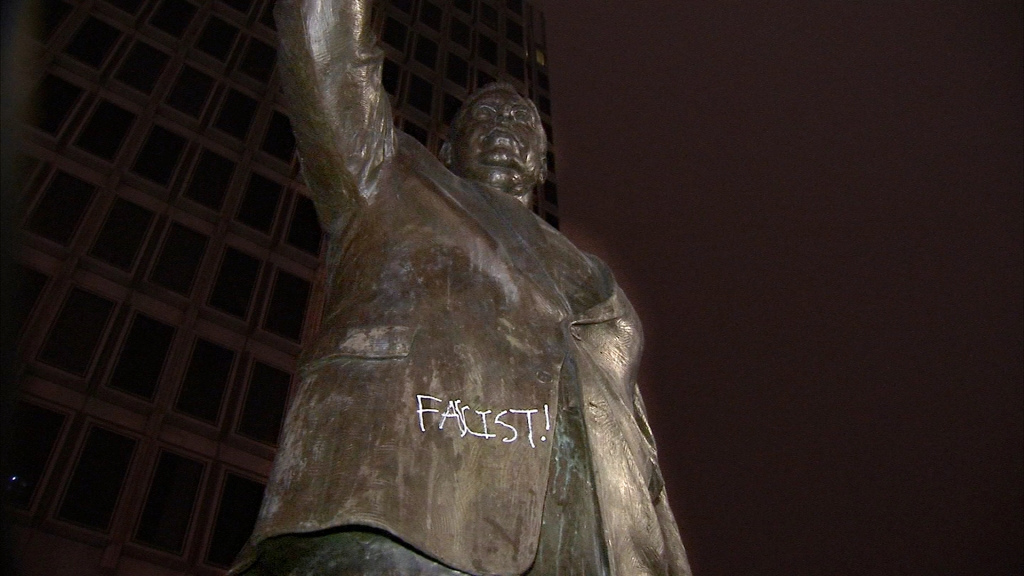 A statue of Frank Rizzo with the word facist tagged on it