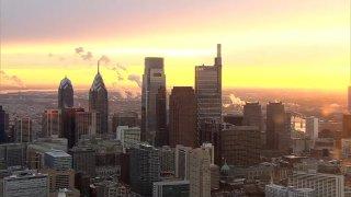 The sun rises of the Philadelphia skyline.