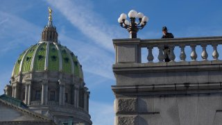 A police officer monitors activity at Pennsylvania's capitol building in Harrisburg.