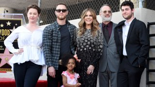 Chet Hanks (second left), Rita Wilson, Tom Hanks and Truman Hanks attend the ceremony honoring Rita Wilson with a star on the Hollywood Walk of Fame