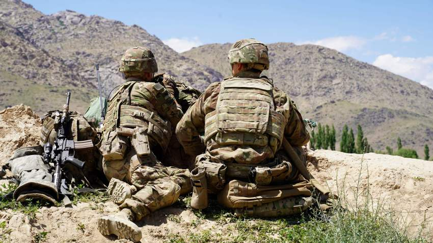 In this photo taken on June 6, 2019, U.S. soldiers look out over hillsides in the Nerkh district of Wardak province, Afghanistan.