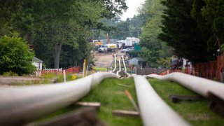 Sections of steel pipe lie in a staging area before being inserted underground as part of the ETP-Sunoco Mariner East 2 pipeline in the Marchwood neighborhood of Exton, Pennsylvania on June 5, 2019