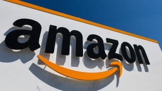A picture shows the Amazon logo at the entrance area of the Amazon logistics centre in Amiens, northern France