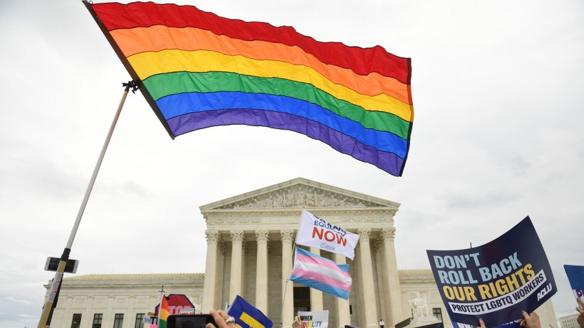 LGBTQ flag flies in front of the U.S. Supreme Court