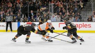 Vegas Golden Knights defenseman Brayden McNabb (3) and Philadelphia Flyers defenseman Ivan Provorov (9) battle for control of the puck during a regular season game