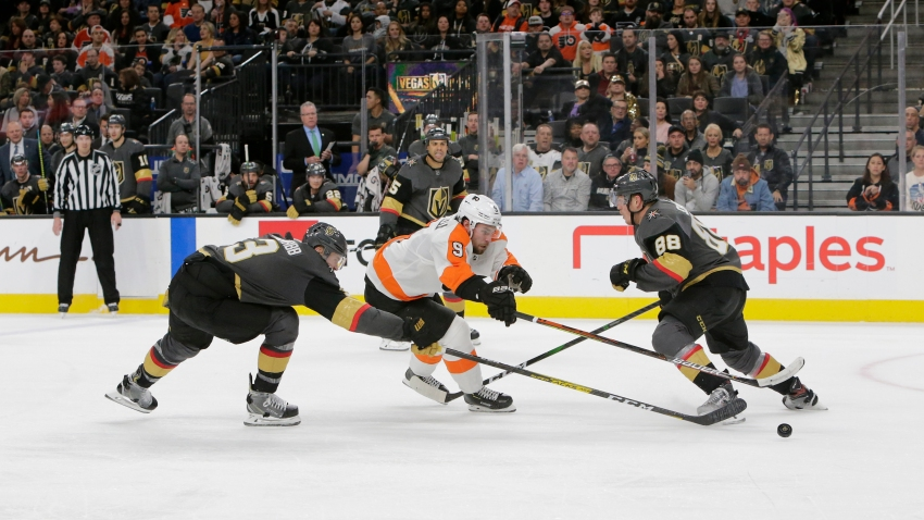 Vegas Golden Knights defenseman Brayden McNabb (3) and Philadelphia Flyers defenseman Ivan Provorov (9) battle for control of the puck during a regular season game
