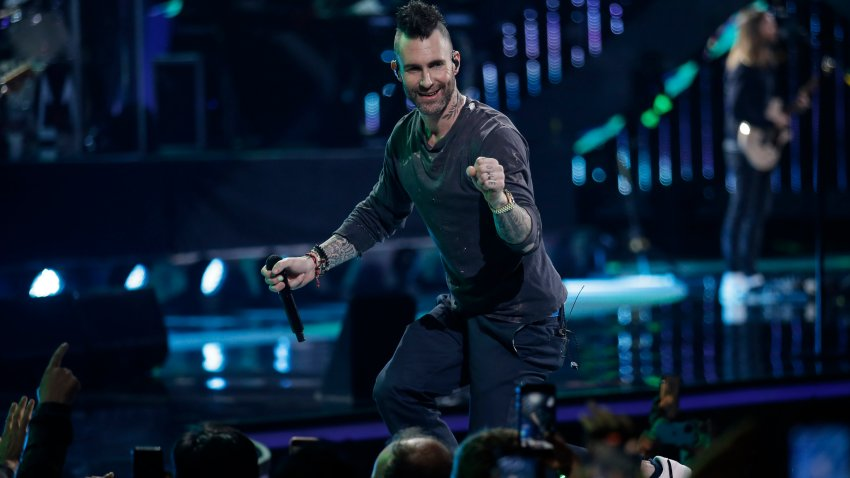 Adam Levine performs onstage