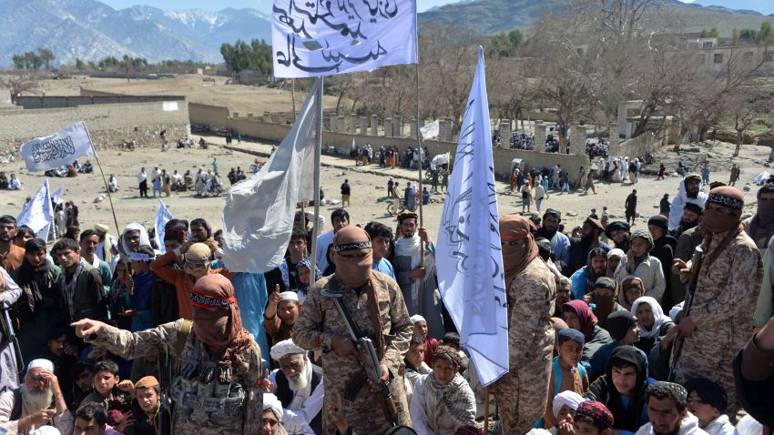 Afghan Taliban militants and villagers attend a gathering as they celebrate the peace deal and their victory in the Afghan conflict on US in Afghanistan, in Alingar district of Laghman Province on March 2, 2020. - The Taliban said on March 2 they were resuming offensive operations against Afghan security forces, ending the partial truce that preceded the signing of a deal between the insurgents and Washington.