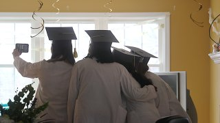 University of Massachusetts Medical School graduate Jacqueline Chipkin, far left, participates in a FaceTime video chat