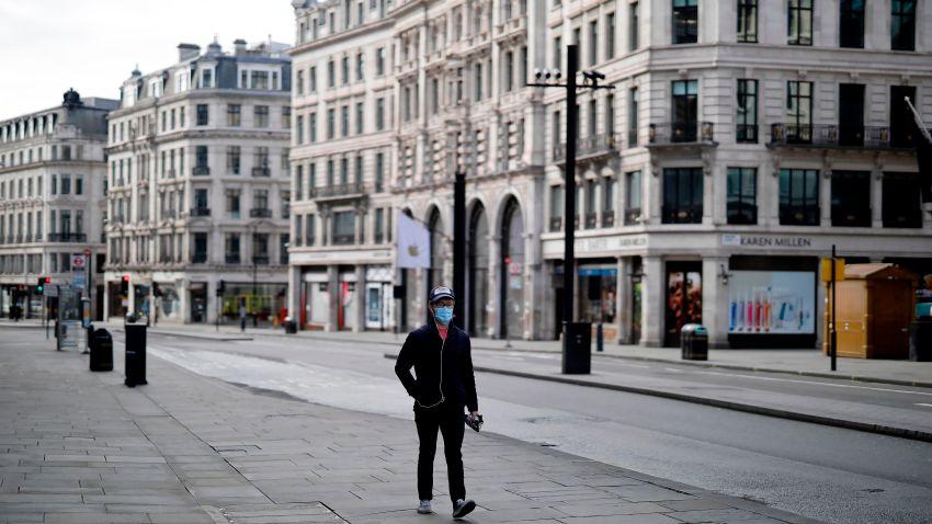 A pedestrian wearing a face mask